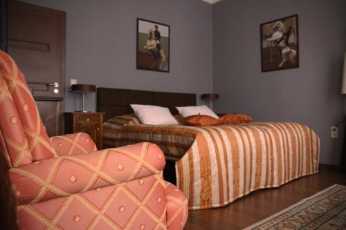 Łóżko lub łóżka w pokoju w obiekcie Moszna Apartments
