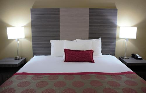 A bed or beds in a room at Ramada by Wyndham Wentzville