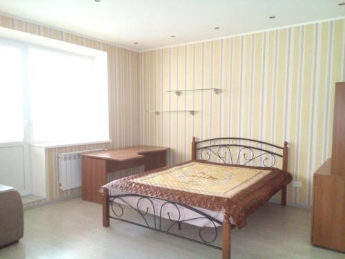 Кровать или кровати в номере Apartment on Lenina 135/2