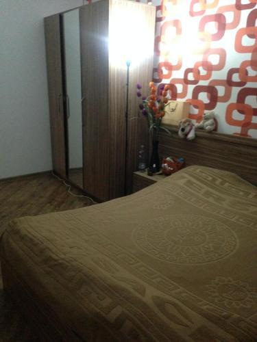 Cama ou camas em um quarto em Guest house Amira