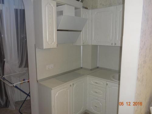 Кухня или мини-кухня в Apartment at Tsyurupy 32