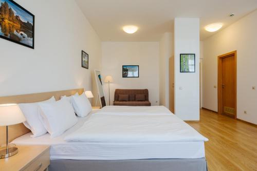 Кровать или кровати в номере Апарт-отель Имеретинский - Заповедный квартал