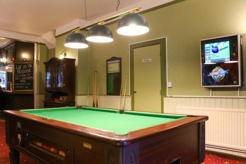 A pool table at The Alexandra Pub