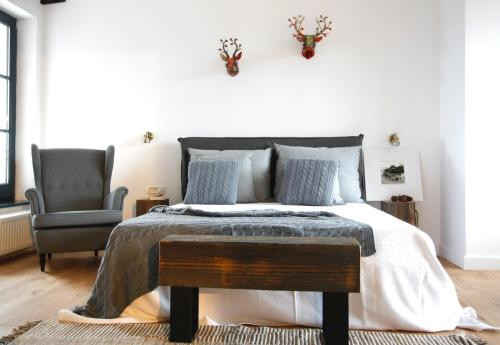 A bed or beds in a room at The Pines Boutique Villa