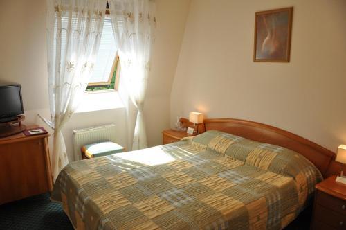 Кровать или кровати в номере Отель Марк