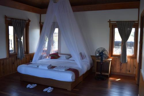 A bed or beds in a room at The Inle Sanctuary,Phayartaung