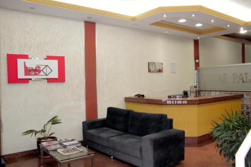 The lobby or reception area at Hotel Minas Palace de Muriaé