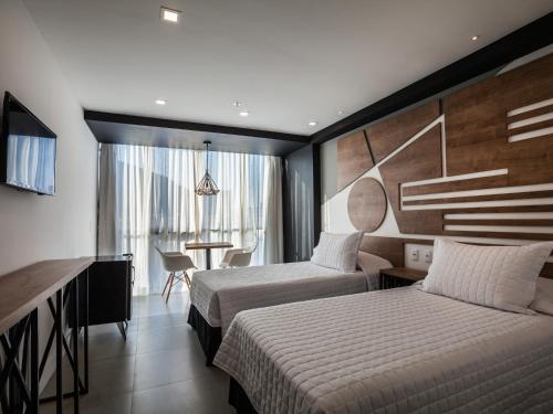 A bed or beds in a room at Rio Design Hotel