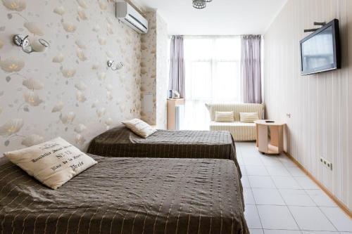 Кровать или кровати в номере Апартаменты «Светлана-Центр»