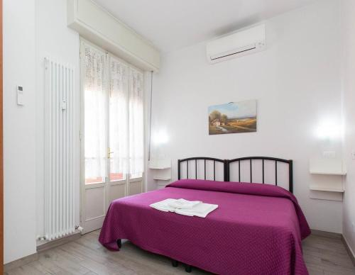 A bed or beds in a room at Il Grillo Di Firenze B&B
