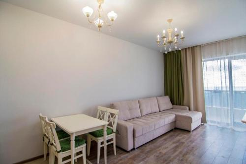 A seating area at Apartment In Ideal House