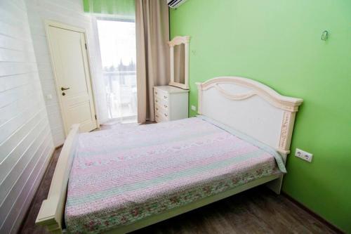 Кровать или кровати в номере Апартаменты Идеал Хаус