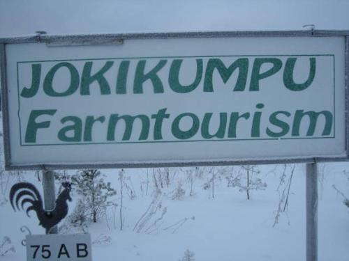 Logotypen eller skylten för lantgården