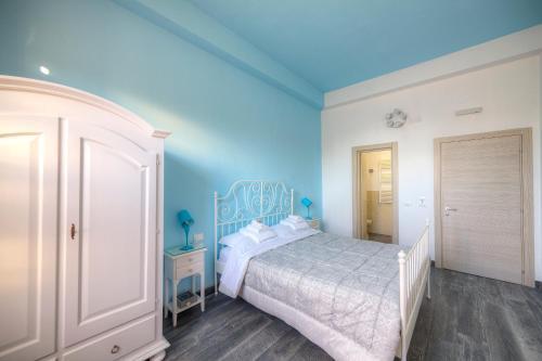 A bed or beds in a room at Il Viaggiator Leggero