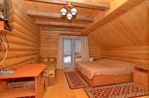 Кровать или кровати в номере Apart-hotel ORLAN