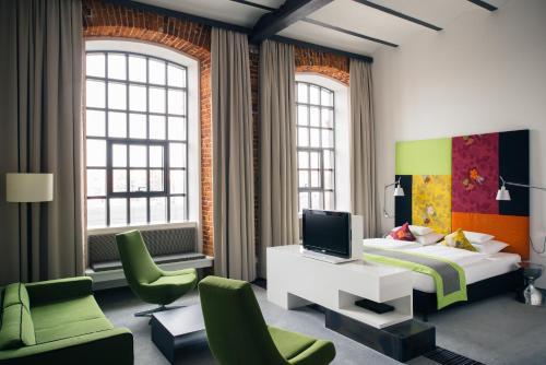Телевизор и/или развлекательный центр в Vienna House Andel's Lodz