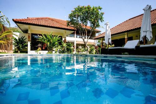The swimming pool at or near Mimpi Nyata by Phocéa