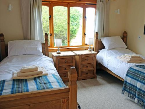 A bed or beds in a room at Holiday Home Fiskavaig