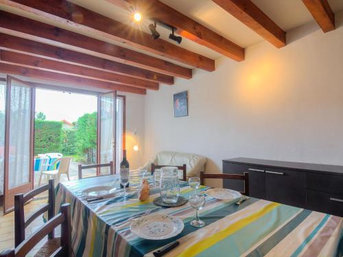 A restaurant or other place to eat at Holiday Home Sicard-1
