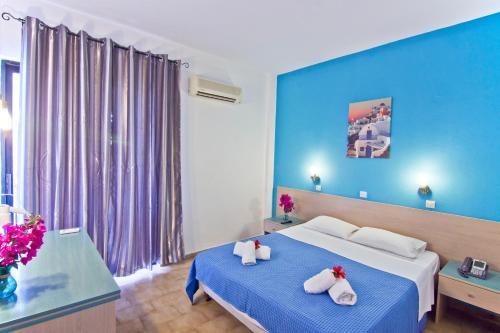 Ένα ή περισσότερα κρεβάτια σε δωμάτιο στο Ξενοδοχείο Αργώ