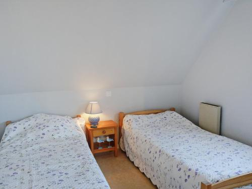 A bed or beds in a room at Apartment Ty Bihan-1