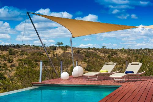 The swimming pool at or near Mahali Mzuri