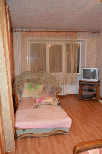 Кровать или кровати в номере Apartaments at Shevchenko 82
