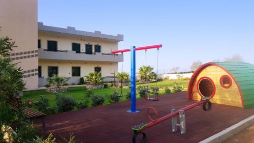 Children's play area at Kritamos Beach Apartments