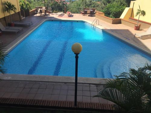The swimming pool at or near Presidential Suites 12