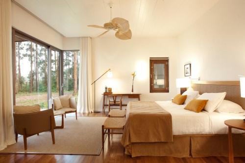 A bed or beds in a room at Puerto Valle Hotel de Esteros