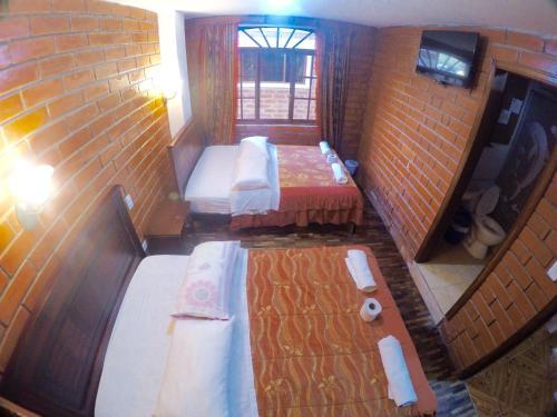 Cama ou camas em um quarto em Hostal Nomada