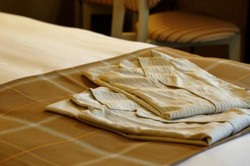 A bed or beds in a room at Hotel Monte Hermana Kobe Amalie