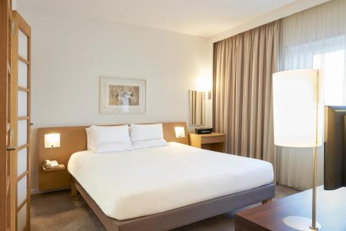 A bed or beds in a room at Novotel London West