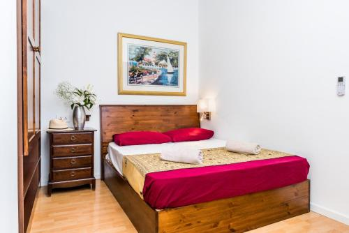 A bed or beds in a room at Marco Polo Party Hostel