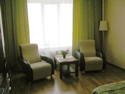 Гостиная зона в Apartment in Center on Lomonosova55