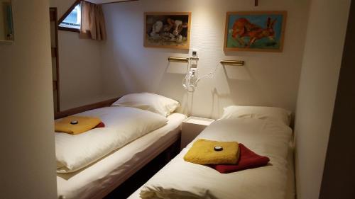 Een bed of bedden in een kamer bij Botel Liza Marleen