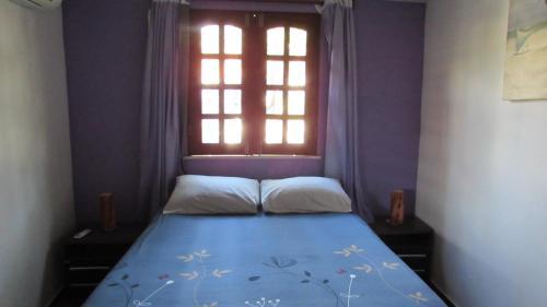 Cama ou camas em um quarto em Pousada da Lucinha