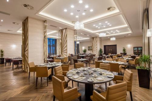 A restaurant or other place to eat at Hilton Podgorica Crna Gora