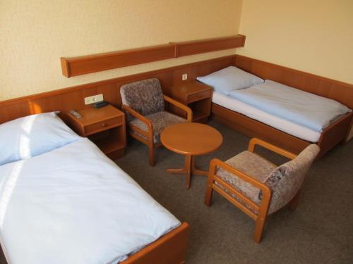 Ein Bett oder Betten in einem Zimmer der Unterkunft Gasthof zum Galik