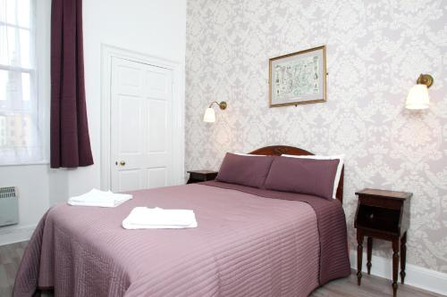 A bed or beds in a room at 52 Charlotte Street