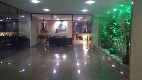 The lobby or reception area at Flat Recife Quarto