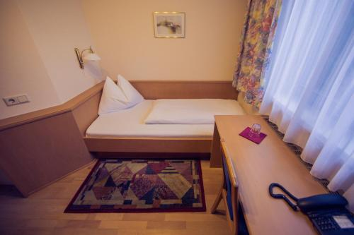 A bed or beds in a room at Gasthof Bokan