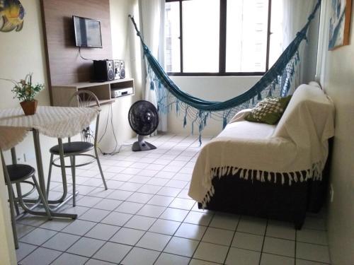 Uma área de estar em Apartamento Ametista 2 + Bykes