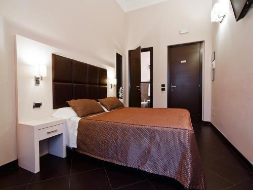 Letto o letti in una camera di Cenci Bed & Breakfast Fontana di Trevi