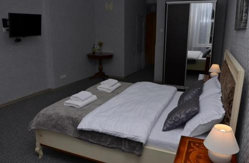 A bed or beds in a room at Free People Hostel