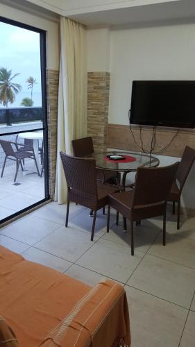 A television and/or entertainment center at Mar do Cabo Branco Beira Mar