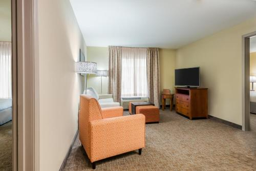 A television and/or entertainment center at Homewood Suites by Hilton St. Louis Riverport- Airport West