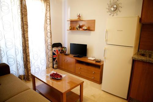 Una televisión o centro de entretenimiento en Apartamento Los Patos