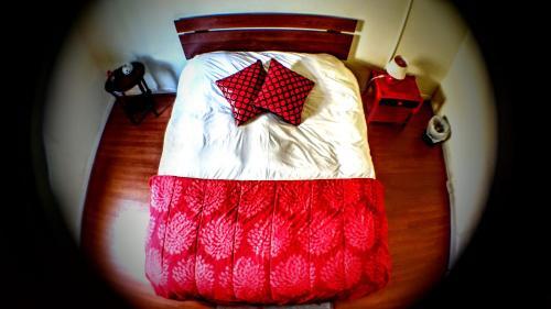 A bed or beds in a room at La Casa Piola
