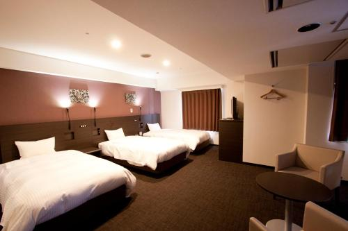 A bed or beds in a room at Smile Hotel Kyoto Shijo